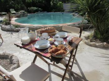 Breakfast served on the terrace by the pool